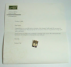 Dawns 5 year pin and letter from SU!