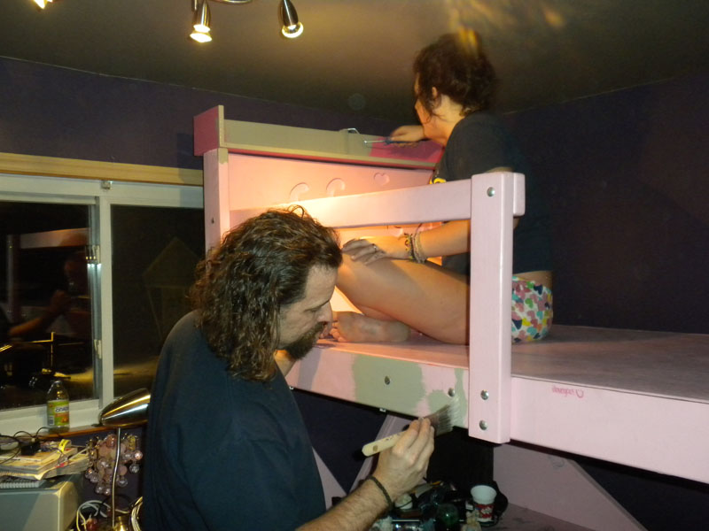 Jessie and Rich painting her bed  Elephant  skin gray