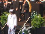 Jess with her diploma coming off stage