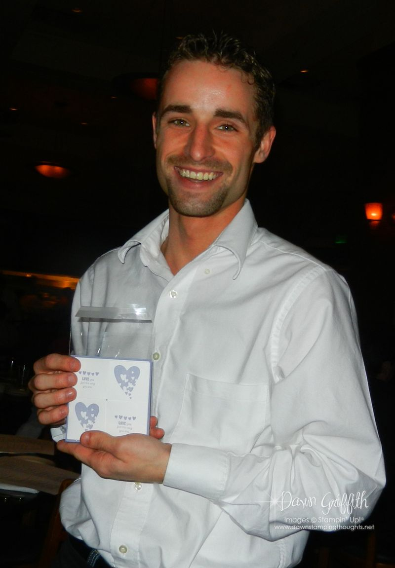 Waiter with the card we made at dinner