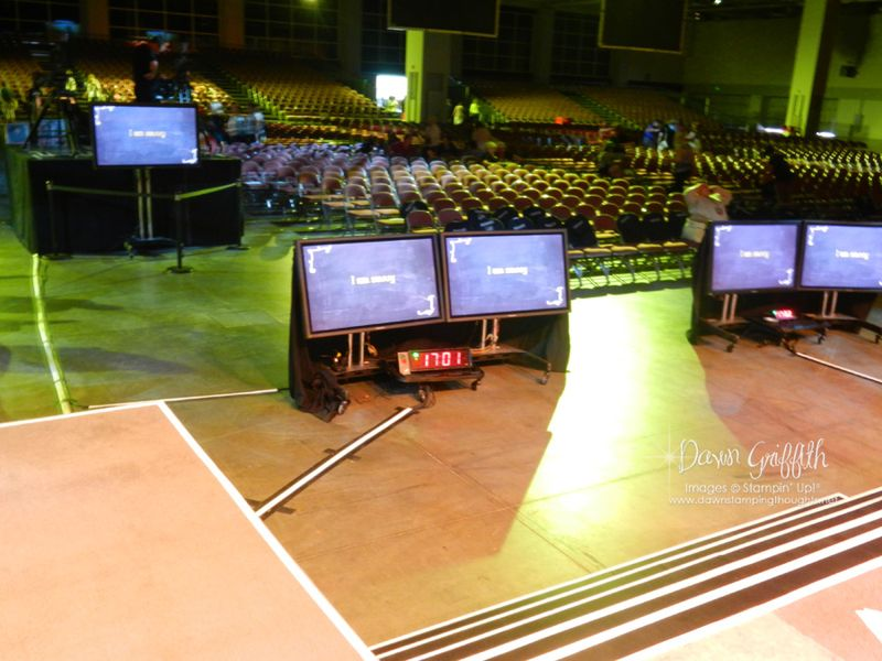 Main stage with video monitors and timers