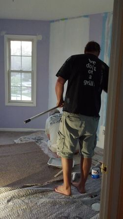 Dad  and Hubby Painting Spare bedroom