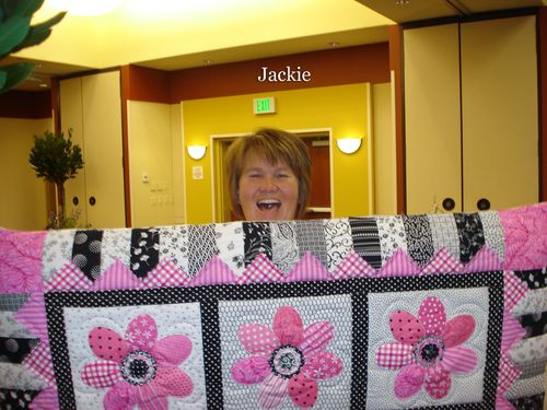 Jackie with Jill Olsens Quilt